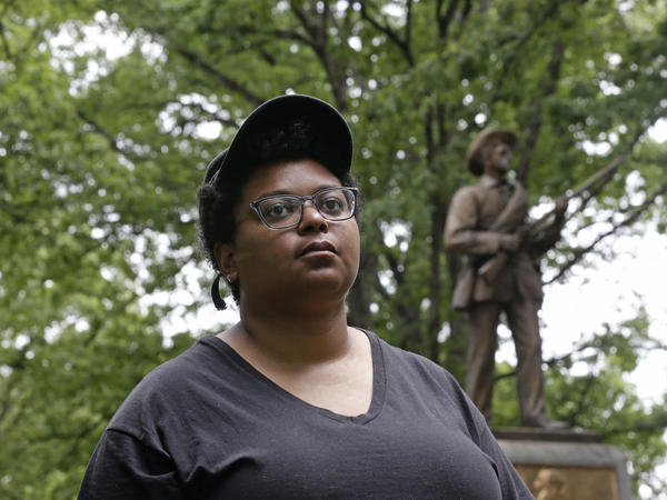 "Activist Maya Little, photographed in May before the toppling of the ""Silent Sam"" Confederate statue at the University of North Carolina at Chapel Hill. Little was arrested and charged on Tuesday, after protesting the university's plans to bring the statue back to campus."