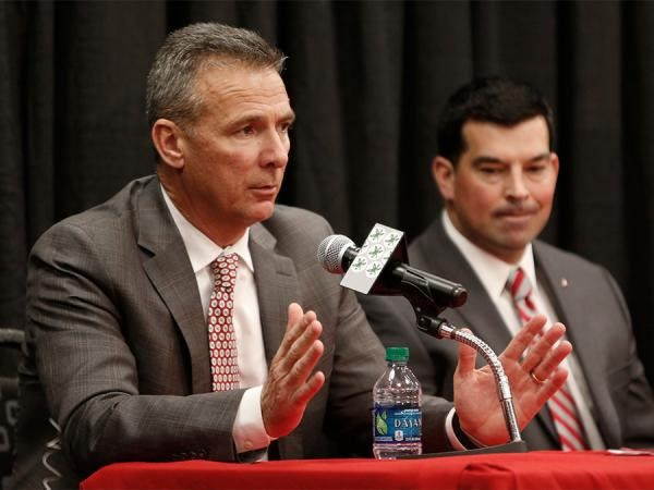 Ohio State football coach Urban Meyer, left, answers questions during a press conference announcing his retirement Tuesday while assistant coach and Ohio State's next coach Ryan Day looks on.