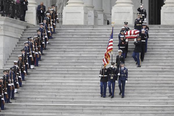 "At the funeral, Bush biographer Jon Meacham praised ""America's last great soldier statesman, a 20th century founding father."""