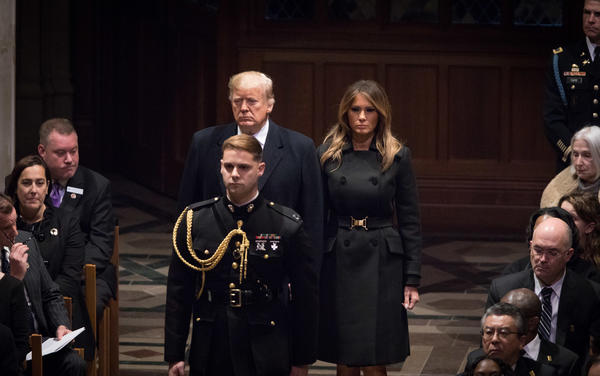 President Trump and first lady Melania Trump arrive for the funeral at Washington National Cathedral on Wednesday.