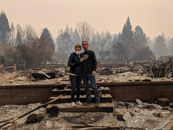 Tamara and Seth Roberts stand in front of the remains of their home in Paradise during a short visit on Nov. 10. It was destroyed in the Camp Fire two days earlier.