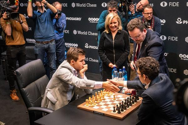 St. Louis grandmaster Fabiano Caruana, right, fell to Norwegian grandmaster Magnus Carlsen in the World Chess Championships in November.