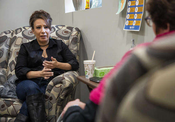 """Lindsay Bunker (left) talks to her counselor Regina Fox (right) at the NorthLakes Community Clinic in Ashland, Wisconsin. Bunker is in treatment for heroin addiction. She says the clinic's approach is helping: """"I love being here. I feel safe. I feel strong. I feel supported."""""""