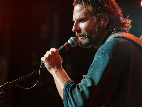 Bradley Cooper plays Jackson Maine, a musician struggling with addiction, in <em>A Star Is Born.</em>