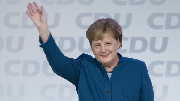 German Chancellor and leader of the German Christian Democrats Angela Merkel waves after her last speech as party leader on Friday in Hamburg, Germany.