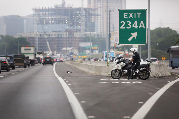 An Austin Police officer on a motorcycle on I-35 near downtown Austin on May 10, 2016.