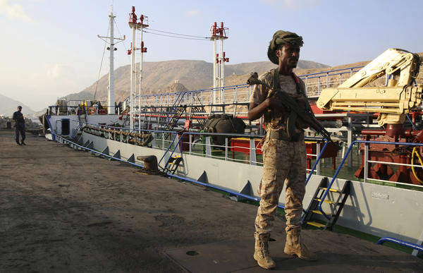 Yemeni militiamen stand guard at the port in Mukalla, on the southern coast of Yemen. Many factions are involved in Yemen's civil war. The U.S. has supported Saudi Arabia, which has waged a bombing campaign against Houthi rebels. But the U.S. Congress is putting pressure on the Trump administration to end its support of a war that's widely seen as a stalemate and a humanitarian disaster.