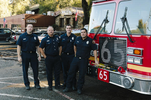"""Los Angeles County firefighters, from left: Brian Knutson, Jay Colvin, Adam Young and Marcus Carballo. Knutson lives in the community and says this is the worst fire any of them can ever remember. """"It's always hard to talk to someone that's lost their house,"""" he says. """"I wish we could have done more for them."""""""