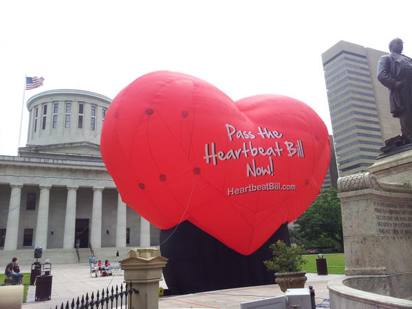 "This photo taken June 5, 2012, outside the statehouse in Columbus, Ohio, shows a large balloon in support of the ""Heartbeat Bill."""