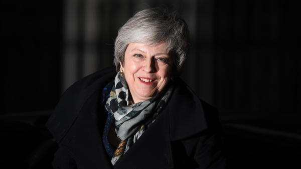 British Prime Minister Theresa May returns to No. 10 Downing St. after the no-confidence vote in London. May ultimately won that vote Wednesday and retained her leadership role in the Conservative Party.
