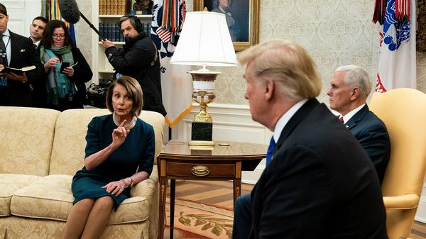 House Minority Leader Nancy Pelosi, D-Calif., the presumptive speaker of the House, and President Trump argue before a meeting at the White House Tuesday.