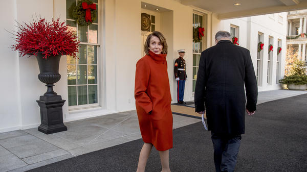 House Minority Leader Nancy Pelosi speaks to a reporter as she and Senate Minority Leader Sen. Chuck Schumer walk back into the West Wing after speaking to members of the media outside of the White House in Washington, D.C., Tuesday.