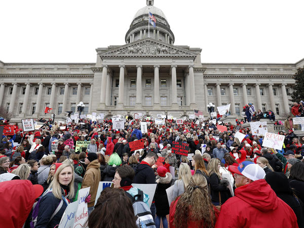 Thousands of public school teachers and their supporters protested against a pension reform bill at the Kentucky state Capitol in April. The state's Supreme Court has now struck down the law.