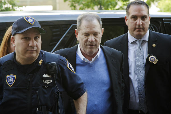 NYPD Detective Nicholas DiGaudio (right), escorts Harvey Weinstein into court in New York City on May 25.