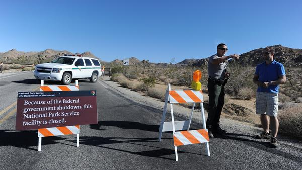 A U.S. park ranger gives a tourist suggestions of other nearby places to visit while Joshua Tree National Park was shut down in 2013.
