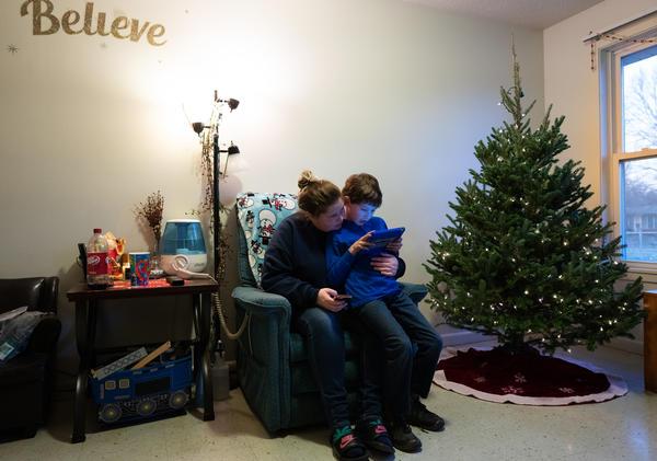 Jillyan Motter holds her younger brother Gabriel Kurtz.