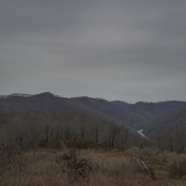 Former coal miner Danny Smith and his family used to ride their ATVs and go camping on this reclaimed strip mining site in Pike County, Ky. But Smith is no longer able to do such things because of his advanced black lung disease.