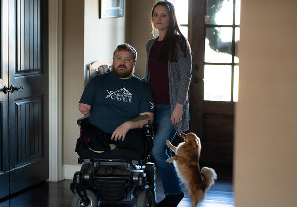 Former Staff Sgt. J.D. Williams poses for a portrait with his wife and caretaker Ashlee Williams.