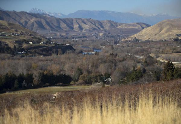 <p>Orchards are shown in the foreground of the Wenatchee Valley on Monday, Nov. 19, 2018, in Wenatchee.</p>