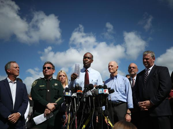 Broward County Public Schools Superintendent Robert Runcie (center) speaks to media in February in Parkland, Fla., the day after the shooting at Marjory Stoneman Douglas High School. He is flanked by Broward County Sheriff Scott Israel (left) and Florida Gov. Rick Scott (right).