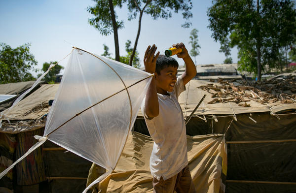 Fayes Khamal tests out a kite he's just made in the Rohingya refugee camp in Bangladesh.
