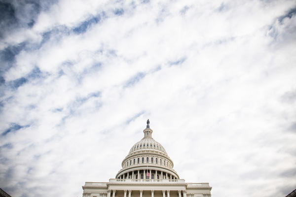 Lawmakers are proceeding with a plan to keep the federal government open through the holidays.