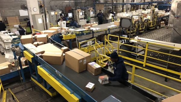 A worker labels packages at a FedEx warehouse in Chicago.