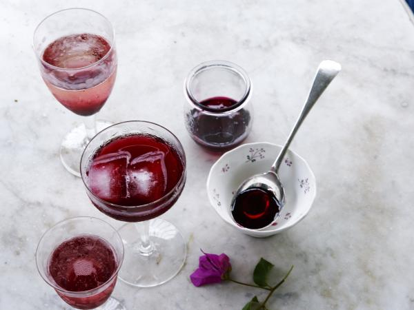 Above, a glass of traditional sorrel and the Rousseau sisters' Sorrel Mimosas (Holiday Hibiscus) made with it.