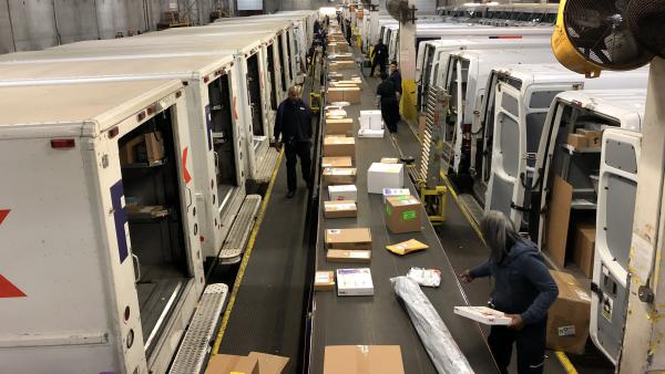Trucks line up in unloading bays at the FedEx Express distribution center on Goose Island near downtown Chicago.