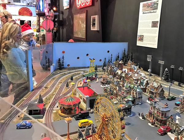 Stephanie Brownlee and her son, George, watch the trains at the Colorado Model Railroad Museum