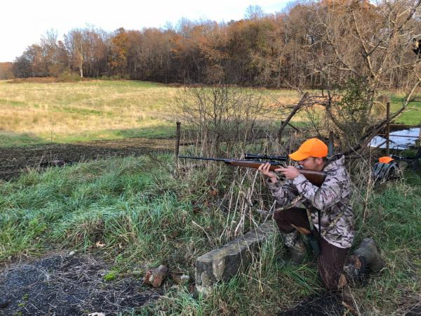 Hunter Cole Cushman looks down the scope of his Browning 7mm rifle.