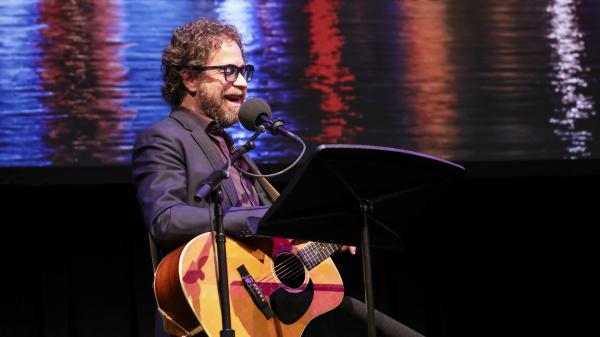 House musician Jonathan Coulton performs a music parody game on <em>Ask Me Another</em> at the Balboa Theatre in San Diego, California.