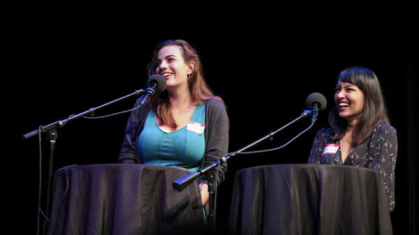 Contestants Sophie Wasserman and Angela Estes compete in trivia games on <em>Ask Me Another</em> at the Balboa Theatre in San Diego, California