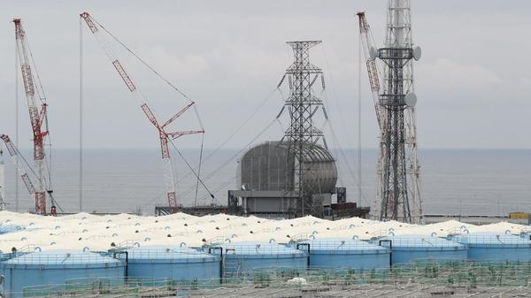 Prosecutors say TEPCO leaders should have known the risks a tsunami could pose to the Fukushima Dai-ichi nuclear power plant, which sits along Japan's eastern coast. Here, the Unit 3 reactor is seen this past summer, amid storage tanks of radiation-contaminated water.