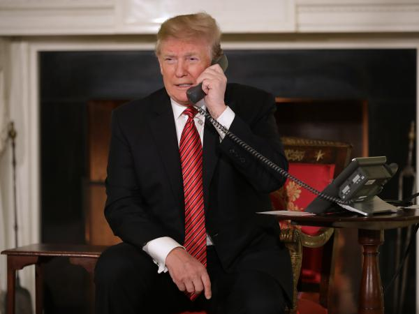President Trump takes phone calls from children as he participates in NORAD's Santa tracker on Christmas Eve at the White House. He caused a stir by asking a 7-year-old caller if she still believed in Santa Claus.