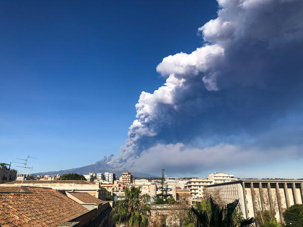 Ash spewing from Mount Etna is seen from the Italian city of Catania on Monday. A 4.8 magnitude earthquake followed, early Wednesday morning.