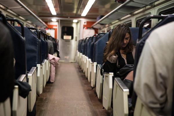 Passengers ride a Hartford Line train during the Christmas holiday weekend. On Amtrak trains on the line, non-Amtrak ticketed passengers are having problems getting on to crowded trains.