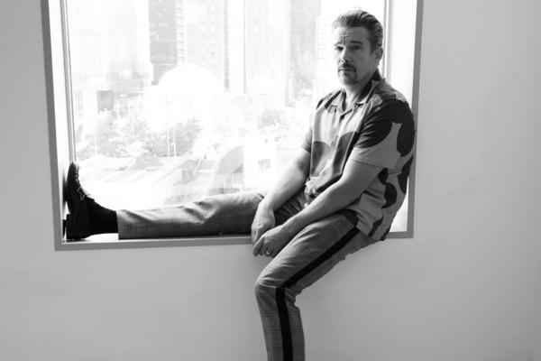 "In this Sept. 6, 2018 photo, actor-director Ethan Hawke poses for a portrait in New York to promote his film ""Blaze."" (Photo by Amy Sussman/Invision/AP)"
