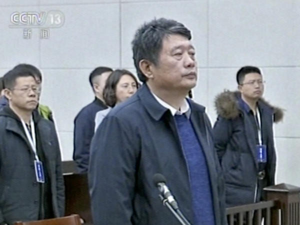 In this image made from CCTV video, China's former deputy intelligence chief Ma Jian appears in a courtroom in the northeastern port city of Dalian, China.