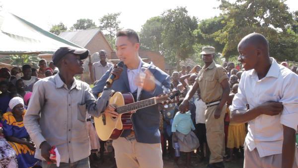 Washington University medical student Jae Lee speaks at the opening of the Empower Through Health clinic in Mpunde, Uganda.