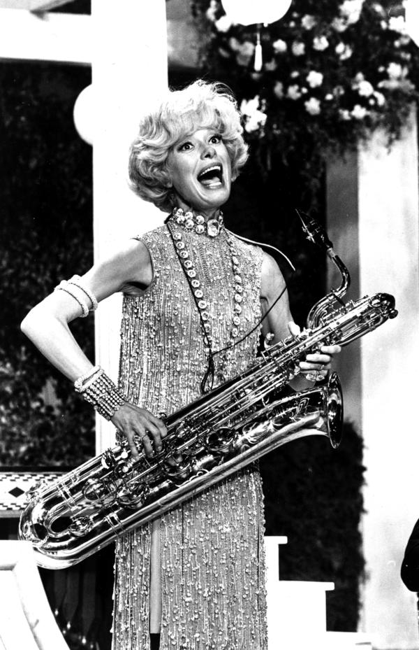 Channing sings and plays the bass saxophone during a rehearsal for the movie <em>Thoroughly Modern Millie</em> in 1966.