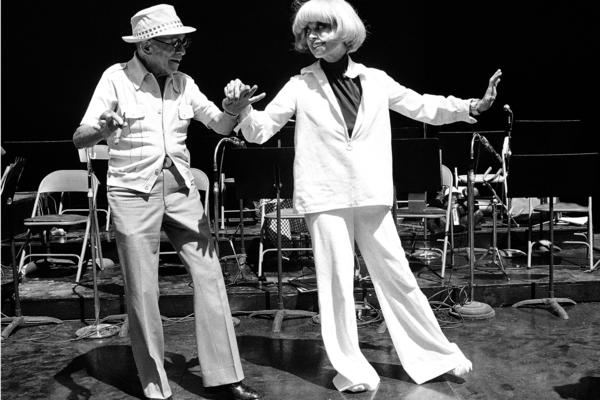 Actor George Burns and Channing perform a dance routine in September 1976 during a rehearsal for their roadshow.