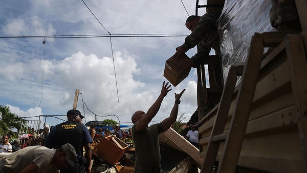 U.S. Army soldiers in Puerto Rico unload food on Oct. 17, 2017. Nearly a month after Hurricane Maria hit, the federal government was still delivering basic supplies, like food and water.