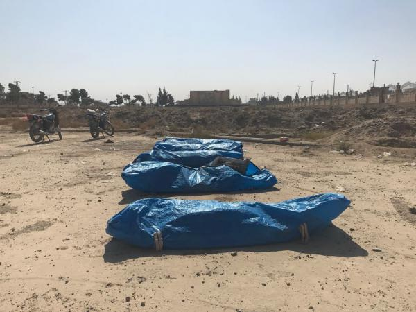 Bodies recovered at a mass grave site that rescuers discovered in Panorama park in Raqqa, Syria. Rescuers say the remains included militants and civilians.