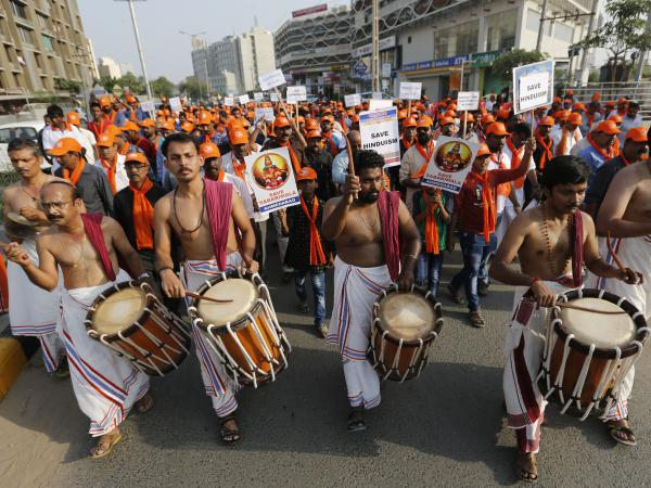 Devotees of Lord Ayyappa, the deity of the Sabarimala temple in India's Kerala state, protest a Supreme Court verdict in Ahmadabad, India, in October. The temple had barred women of menstruating age from entering the temple, but India's Supreme Court struck down the ban.