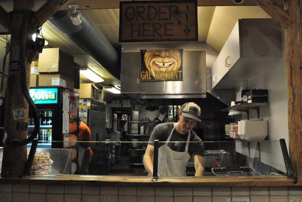 """Josh Painter makes a burrito in a tamale shop in Crested Butte, Colorado. He moved to town after reading about it in a list of """"America's last ski towns."""" But if the cost of living continues to rise, he's prepared to leave."""