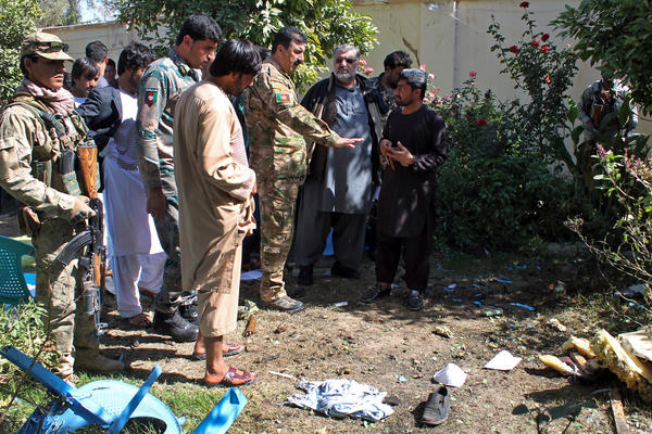 Security forces investigate an explosion that killed Abdul Jabar Qahraman, a candidate in parliamentary elections, at his home, in Lashkar Gah, the capital of southern Helmand Province, in October.