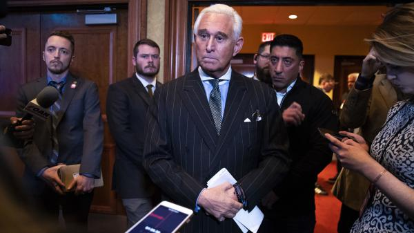 Political strategist Roger Stone talks to reporters at the American Priority Conference on Dec. 6, in Washington, D.C.