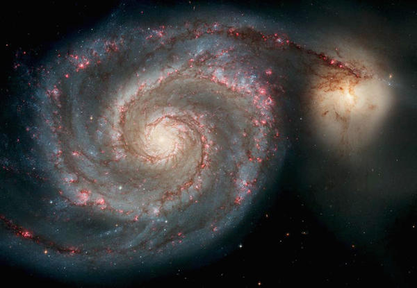 This image, released on April 25, 2005 for the Hubble Space Telescope's 15th anniversary, shows the Whirlpool Galaxy.