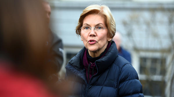Massachusetts Sen. Elizabeth Warren speaks to reporters outside her home in Cambridge, Mass., on Dec. 31, after announcing plans to explore a campaign for the 2020 Democratic presidential nomination.